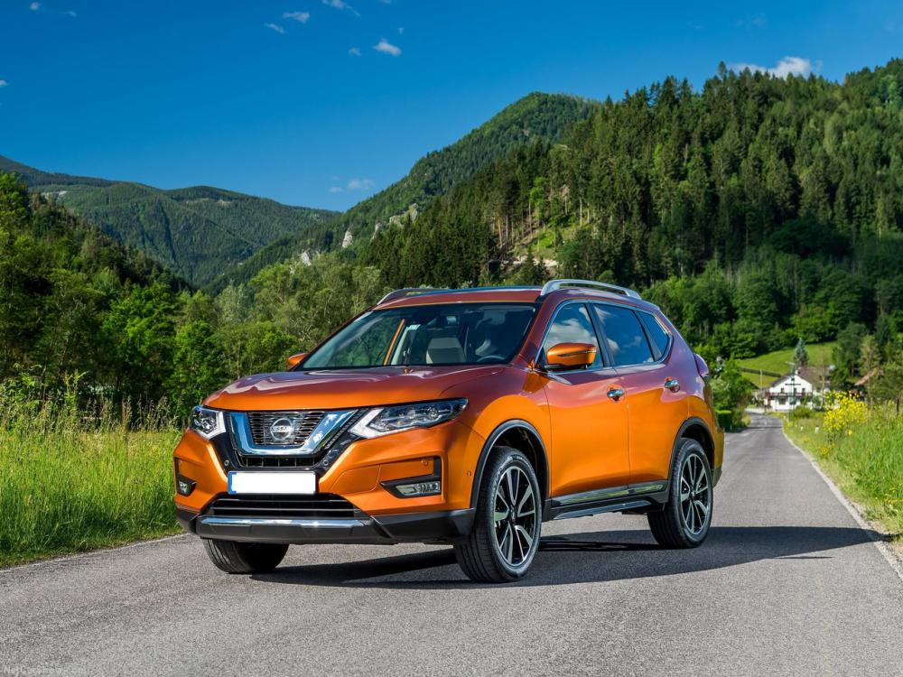 Nissan x-trail de color naranja, la camioneta X Trail