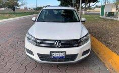 Pongo a la venta cuanto antes posible un Volkswagen Tiguan en excelente condicción-3