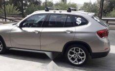 Carro BMW X1 2014 en buen estadode único propietario en excelente estado-8