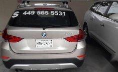 Carro BMW X1 2014 en buen estadode único propietario en excelente estado-6