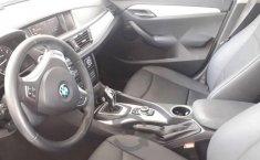 Carro BMW X1 2014 en buen estadode único propietario en excelente estado-5