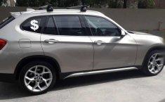 Carro BMW X1 2014 en buen estadode único propietario en excelente estado-1