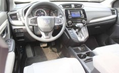Pongo a la venta un Honda CR-V en excelente condicción-6