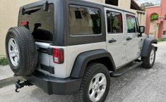 Jeep Wrangler Unlimited Sport 2012 3er. dueño RINES 18 originales LLANTAS SEMINUEVAS 4x4 IMPECABLE!!-1
