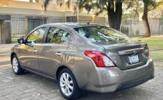Versa advance equipado excelen 1 dueña nunca uber-2
