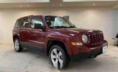 Pongo a la venta cuanto antes posible un Jeep Patriot en excelente condicción-13