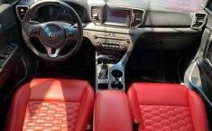 Pongo a la venta cuanto antes posible un Kia Sportage en excelente condicción-12