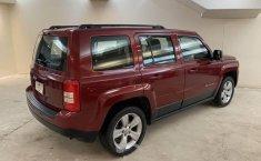 Pongo a la venta cuanto antes posible un Jeep Patriot en excelente condicción-2