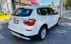 Auto BMW X3 2015 de único dueño en buen estado-11