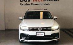 Pongo a la venta cuanto antes posible un Volkswagen Tiguan en excelente condicción-10