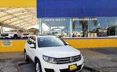 Auto Volkswagen Tiguan 2013 de único dueño en buen estado-13