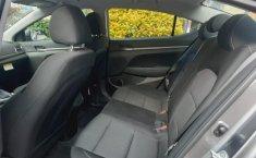 Pongo a la venta cuanto antes posible un Hyundai Elantra en excelente condicción-12