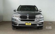 Auto BMW X5 2014 de único dueño en buen estado-6