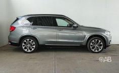 Auto BMW X5 2014 de único dueño en buen estado-5