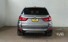 Auto BMW X5 2014 de único dueño en buen estado-0