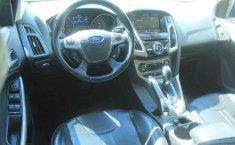 Pongo a la venta cuanto antes posible un Ford Focus en excelente condicción-12