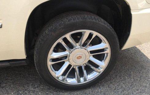 Un Cadillac Escalade 2013 impecable te está esperando