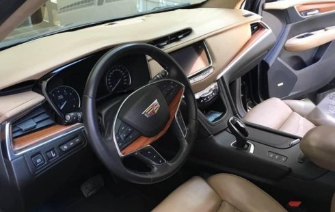 Quiero vender un Cadillac XT5 en buena condicción