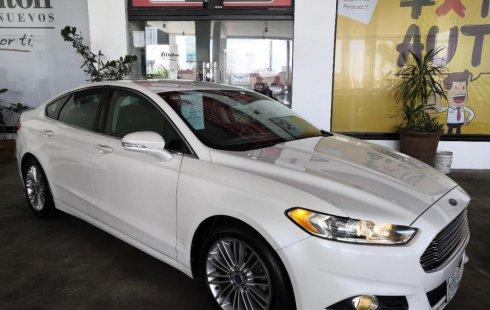 Quiero vender inmediatamente mi auto Ford Fusion 2013 muy bien cuidado