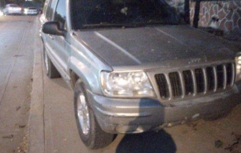 Vendo un carro Jeep Grand Cherokee 2001 excelente, llámama para verlo