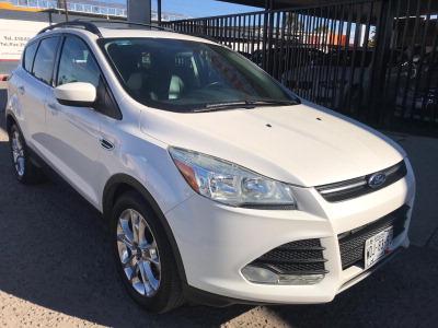 Quiero vender urgentemente mi auto Ford Escape 2013 muy bien estado