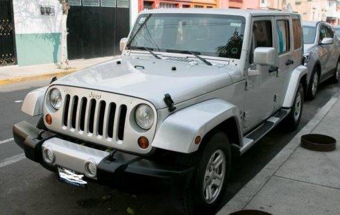 Quiero vender inmediatamente mi auto Jeep Wrangler 2010