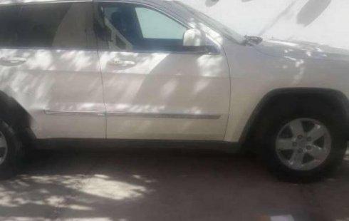Quiero vender inmediatamente mi auto Jeep Grand Cherokee 2012
