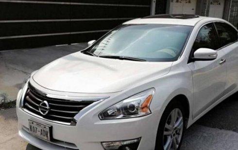 Tengo que vender mi querido Nissan Altima 2013 en muy buena condición