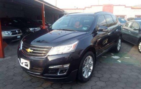 Un Chevrolet Traverse 2015 impecable te está esperando
