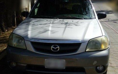 Quiero vender cuanto antes posible un Mazda TRIBUTE 2002