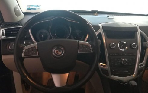 Quiero vender inmediatamente mi auto Cadillac SRX 2012 muy bien cuidado