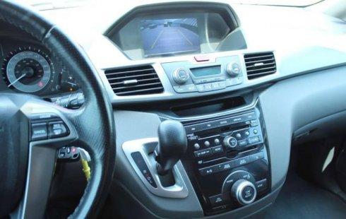 Vendo un carro Honda Odyssey 2013 excelente, llámama para verlo
