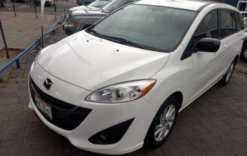 Vendo un carro Mazda 5 2015 excelente, llámama para verlo