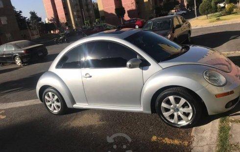 Un Volkswagen Beetle 2011 impecable te está esperando