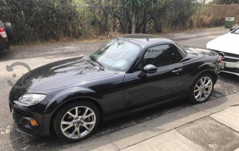 Tengo que vender mi querido Mazda MX-5 2015 en muy buena condición