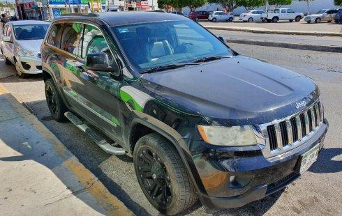 Quiero vender inmediatamente mi auto Jeep Grand Cherokee 2013
