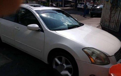 Quiero vender un Nissan Maxima en buena condicción