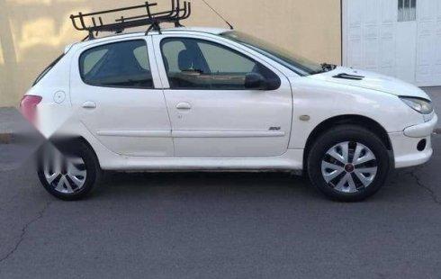 Tengo que vender mi querido Peugeot 206 2000 en muy buena condición
