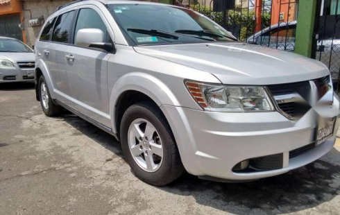 Un Dodge Journey 2010 impecable te está esperando