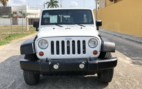 Tengo que vender mi querido Jeep Wrangler 2012 en muy buena condición