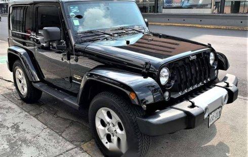 Quiero vender urgentemente mi auto Jeep Wrangler 2014 muy bien estado
