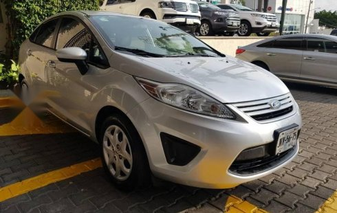 Tengo que vender mi querido Ford Fiesta 2013 en muy buena condición