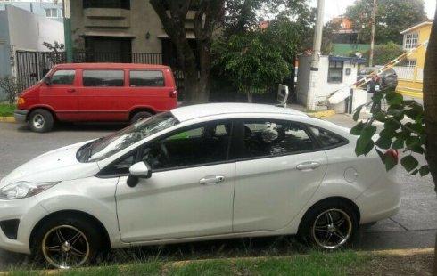 Quiero vender inmediatamente mi auto Ford Fiesta 2012
