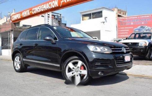 Vendo un carro Volkswagen Touareg 2013 excelente, llámama para verlo