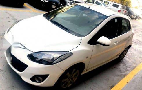 Quiero vender urgentemente mi auto Mazda Mazda 2 2012 muy bien estado