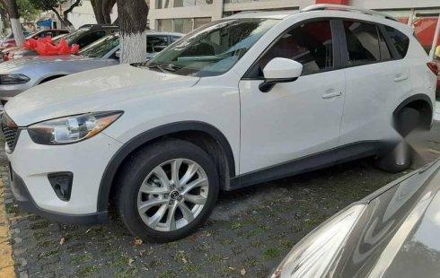 Vendo un carro Mazda CX-5 2014 excelente, llámama para verlo