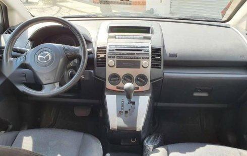 Vendo un carro Mazda Mazda 5 2010 excelente, llámama para verlo