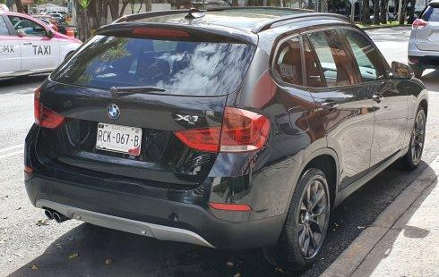 Vendo un carro BMW X1 2014 excelente, llámama para verlo