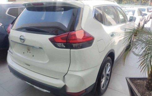Un carro Nissan X-Trail 2019 en Huixquilucan