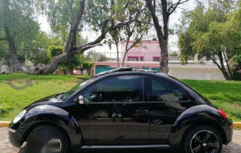 Un Volkswagen Beetle 2010 impecable te está esperando